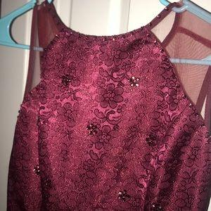 A short burgundy dress